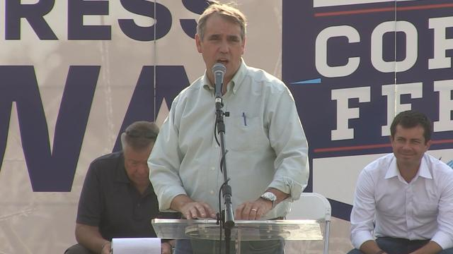 U.S. Sen. Jeff Merkley, of Oregon, talks about climate change in his speech at the Progress Iowa Corn Feed fundraiser on Sunday, Sept. 10, 2017, in Des Moines.