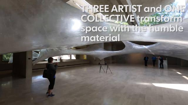 The humble material, tape, is used to create installations at the Des Moines Art Center. A person can climb inside one of the pieces.