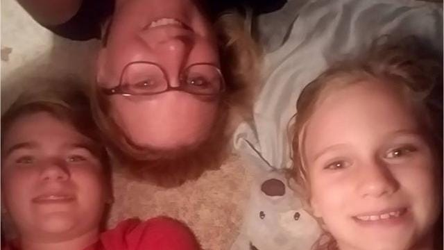 """Katie Hoeppner, 34, of Marion, Ia., found a stuffed animal Sept. 30 at a rest stop near Williamsburg. She is trying to locate the owners of the toy she named """"George"""" while her family has fun documenting their adventures together."""