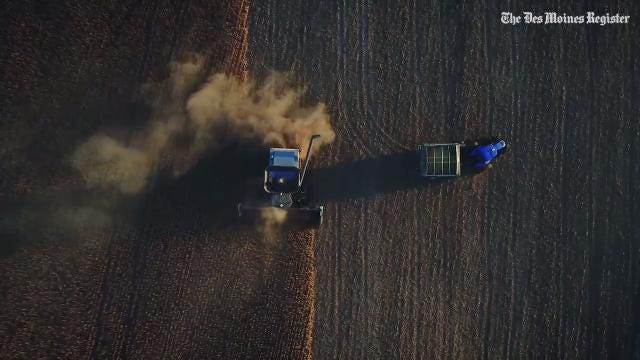 Roger Zylstra harvest soybeans on his farm near Kellogg, Iowa, in 2017, working into the night to catch up after a wet week.