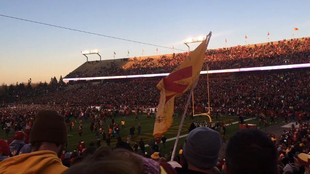 Iowa State fans storm Jack Trice after the Cyclones beat No. 4 TCU