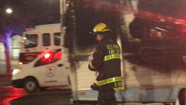 Firefighters rescued a dog who was trapped in an RV that caught fire in a Wal-Mart parking lot on Southeast 14th Street in Des Moines on Friday evening.