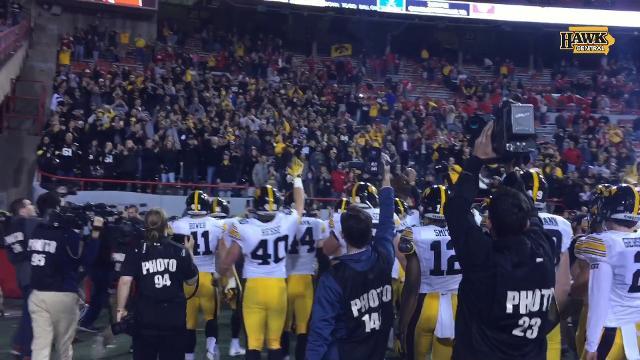 Iowa players enjoy a 56-14 rout of Nebraska.