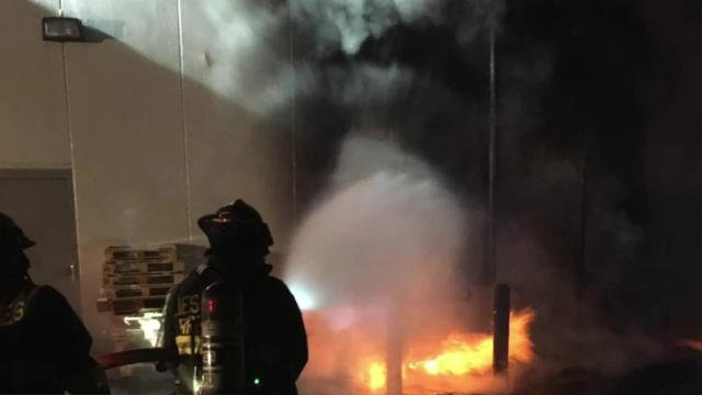 Fire officials are investigating a gas meter blaze that charred the side of an office supply building Thursday night in the city's River Bend neighborhood.