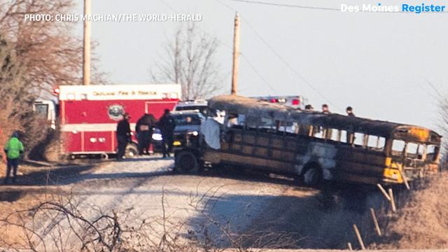 Dispatchers from the Pottawattamie County Sheriff's Office call out for emergency workers to respond to a fatal school bus fire in Oakland, Iowa.