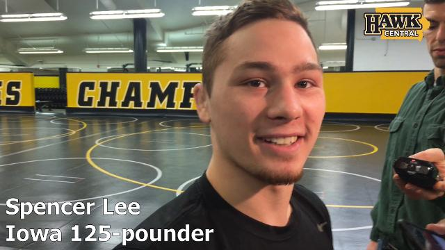 Iowa true freshman Spencer Lee discusses his debut and when he'll wrestle next, with a fun interruption by coach Tom Brands.