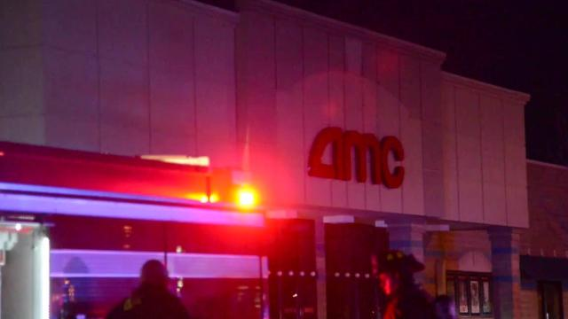 Moviegoers were evacuated Monday afternoon from an AMC movie theater in Urbandale after customers reported a fire on the roof, fire officials said.