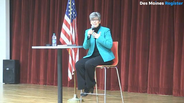 Ernst's defense of Trump met with groans and applause