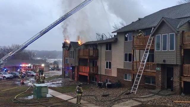 Metro firefighters battle a three-alarm apartment blaze on Office Park Road in West Des Moines