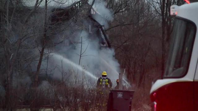 A blaze destroyed a large, two-story abandoned home Friday afternoon on the northeast side of Des Moines.