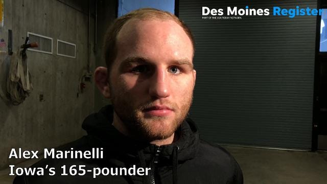 Alex Marinelli recorded a first-period pin on Sunday in Iowa's win over Iowa State.
