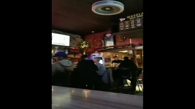 A video posted online Monday appears to show Iowa Senate Majority Leader Bill Dix kissing a female lobbyist in a Des Moines tavern