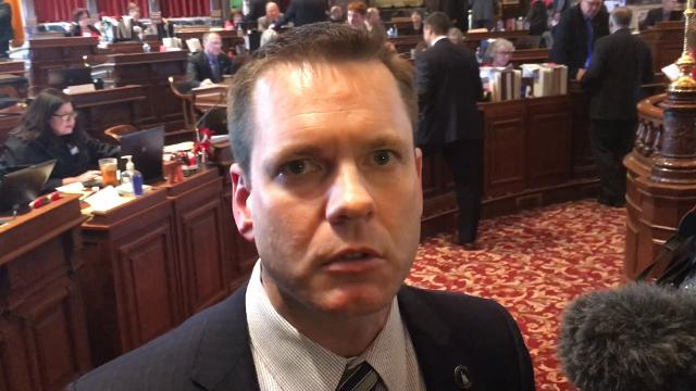 Sen. Charles Schneider, R-West Des Moines, chairman of the Iowa Senate Appropriations Committee, talks with reporters Monday about the sudden resignation of Senate Majority Leader Bill Dix from the Iowa Senate.