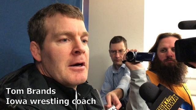 Iowa coach Tom Brands reacts after the Hawkeyes clinched third place in the team race at the NCAA Wrestling Championships.