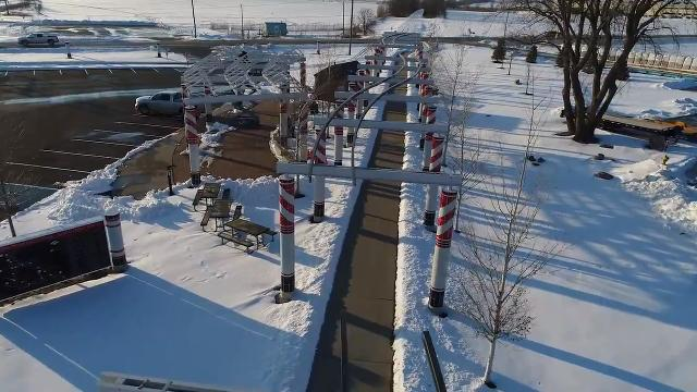The Waukee Railroad Pergola: In the Shadows of the Rails was designed by RDG and pays homage to Waukee's railroad history. A grand opening and ribbon cutting ceremony is planned for March 27.