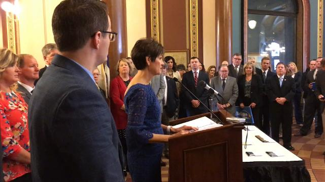 Gov. Kim Reynolds talks at bill-signing ceremony for mental health and suicide prevention legislation at the Iowa Capitol March 29, 2018.