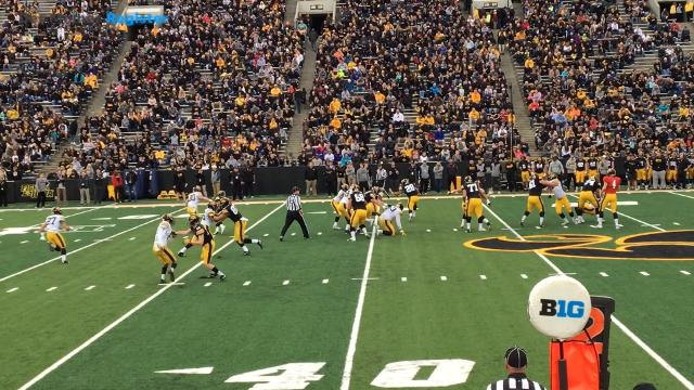 Toren Young rips of a 20-yard run in Iowa's open practice Friday night.