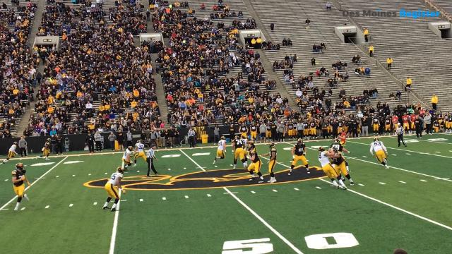 Amani Hooker snags an interception during Iowa's open practice on Friday.
