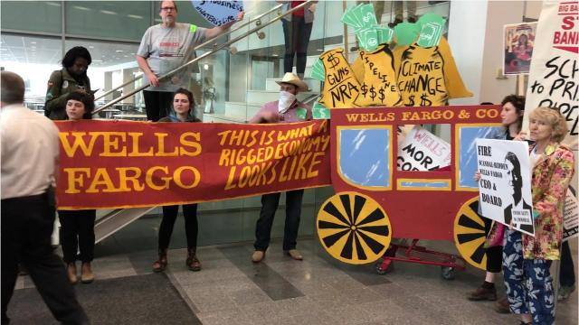 Dozens of protesters rallied in downtown Des Moines as Wells Fargo held it's annual shareholders meeting in Iowa.