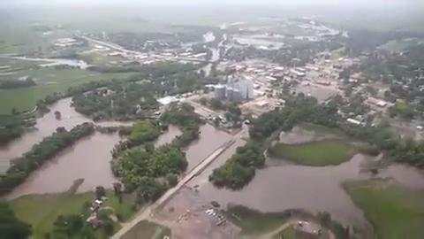 Iowa governor Terry Branstad visited Lyon and Sioux county to assess damage and visit with victims of flooding in Northwest Iowa on Wednesday, June 18, 2014.