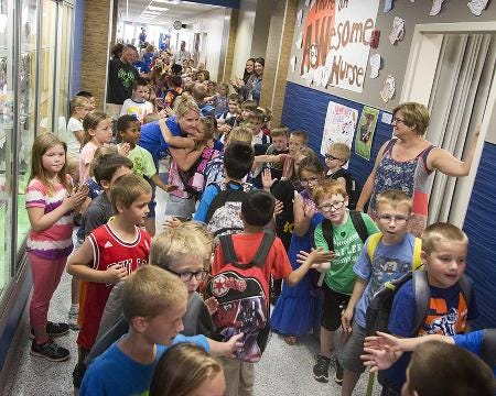 From 2016: Second graders get high fives and fist bumps on the last day of school at Morris Elementary School in Bondurant.
