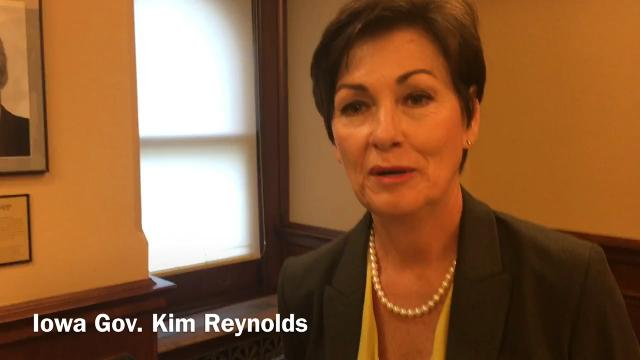 Iowa Gov. Kim Reynolds won't rule out changes in public pension programs, but says she will honor commitments already made for retirement benefits.