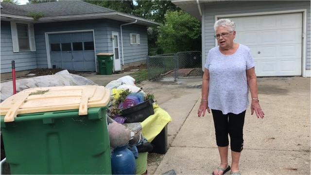 Indianola resident Sandy Guest talks about the garbage pile located in the 800 block of West Salem Ave. in Indianola.