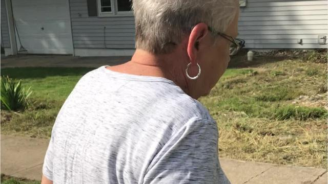 Sandy Guest discusses a home in the 800 block of West Salem Avenue that has been an eyesore in her neighborhood for months.