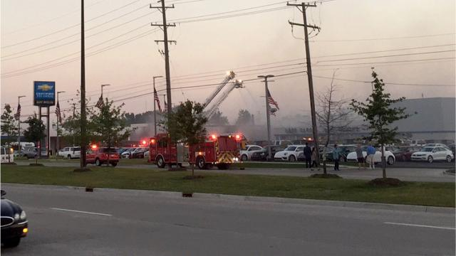 A Sterling Heights car dealership reopened for business this morning -- a day after a fire tore through its service department and destroyed 20 vehicles.
