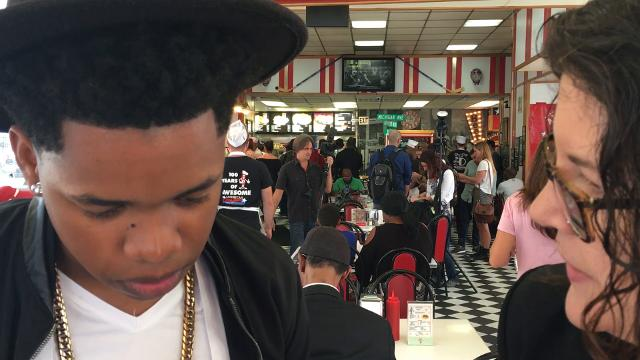 'Detroit' cast members hand out 316 American Coney Island dogs for Detroit's 316th birthday coney dog giveaway.