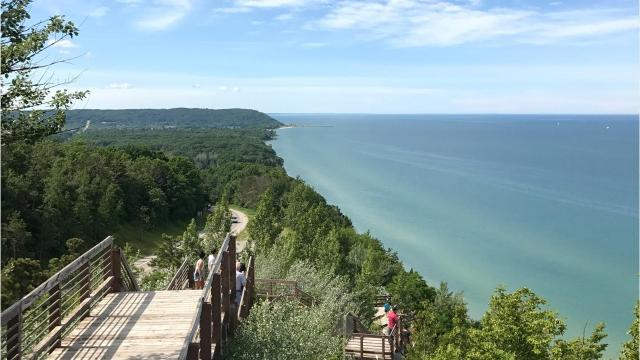 """So what's the deal with M-22? We look at Michigan's most scenic drive along the Lake Michigan coastline and a cultural phenomenon of the Great Lakes State's """"Up North."""" Video by Brian Manzullo, DFP."""