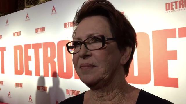 """Julie Delaney, one of the survivors of the Algiers Motel incident during the 1967 riot, walks the red carpet at the """"Detroit"""" movie premiere."""