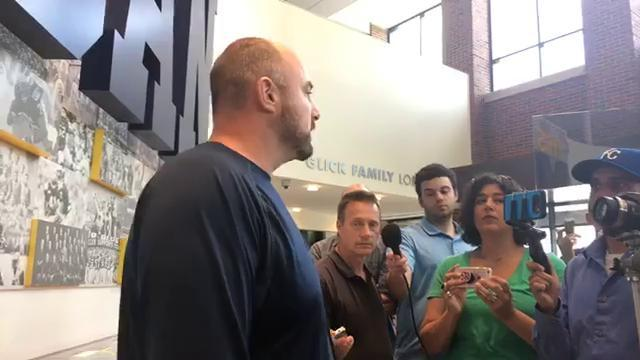 Michigan's Chris Partridge gives an update the defense