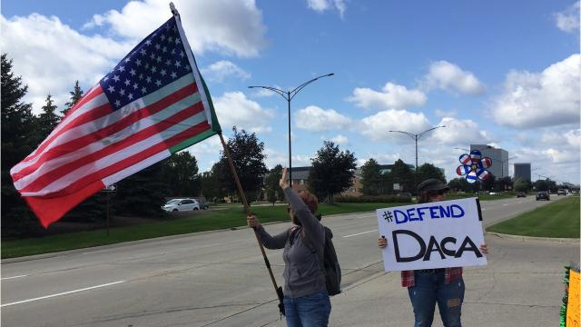 More than 100 people showed up outside of U.S. Rep. David Trott's Troy office to urge the congressman to support the Deferred Action on Childhood Arrivals program that protects young immigrants,