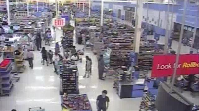 A woman was hit in the head and pepper sprayed during a fight near the checkout lanes at a Walmart in Dearborn.