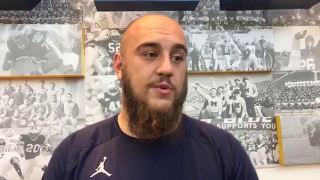 Michigan offensive lineman Patrick Kugler talks with reporters Sept. 11, 2017, after the Wolverines beat Cincinnati 36-14. By George Sipple, DFP.
