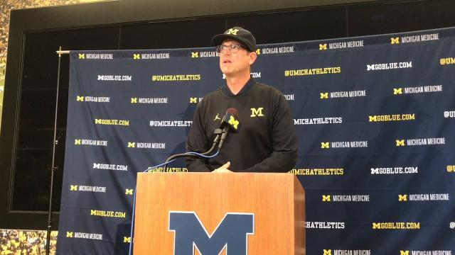 Michigan head football coach Jim Harbaugh answers questions during his weekly press conference.