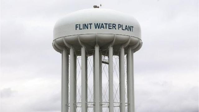 The highest-ranking government official charged in the Flint water investigation, Nick Lyon, heads to court.