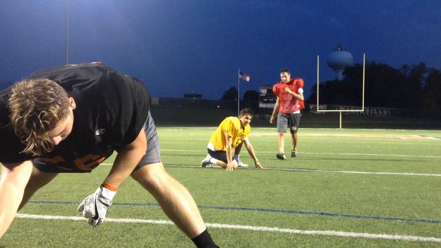 Northville standout senior kicker Jake Moody explains the anatomy of a field goal and extra point kick, at Northville high school on Sept. 18, 2017.