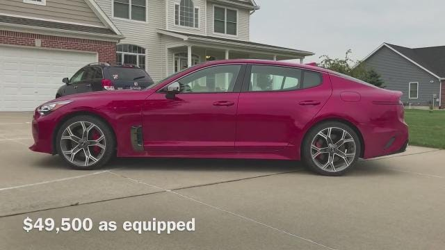 Free Press auto critic Mark Phelan takes a first drive with the 2018 Kia Stinger, an eye-catching sport sedan with performance and value that targets Audi and BMW.