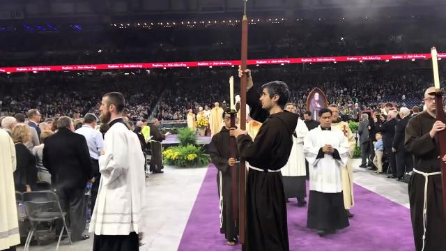 Watch the clergy procession at the Father Solanus Casey beatification mass at Ford Field in Detroit.