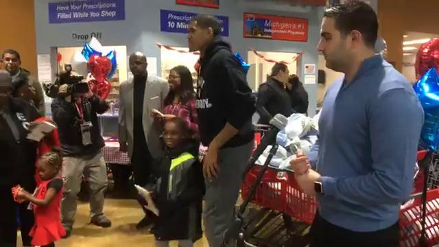 Detroit Pistons forward Tobias Harris gives out turkeys for Thanksgiving at Imperial Fresh Market in Detroit on Tuesday, Nov. 21, 2017.