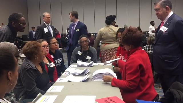 Volunteers begin to recount the Detroit City Clerk election.