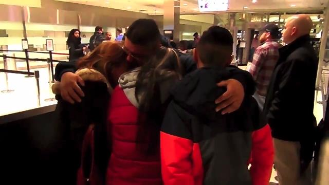 Jorge Garcia, 39, of Lincoln Park, hugs his wife and two kids before being escorted by ICE agents to be deported to Mexico, on Jan. 15, 2018, at Detroit Metro Airport.