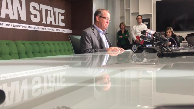 Mark Hollis retires as Michigan State's athletic director in the wake of the Larry Nassar sexual assault scandal.