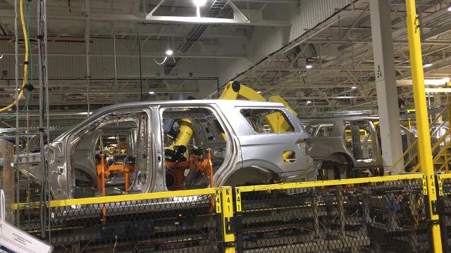 """Kentucky Ford plant's """"Kong"""" robot lifts an SUV body onto a chassis."""