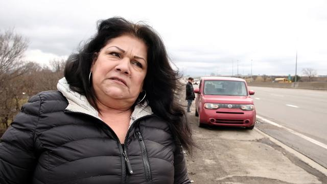 Angry motorists talk about potholes creating a constant stream of vehicles to pull off on northbound I-75 in Detroit causing bent rims and flattening tires.