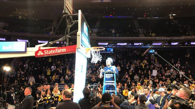 After winning its second straight Big Ten tournament title, this time over Purdue, 75-66, Michigan men's basketball team celebrated by cutting down the nets at Madison Square Garden in New York on Sunday, March 4.