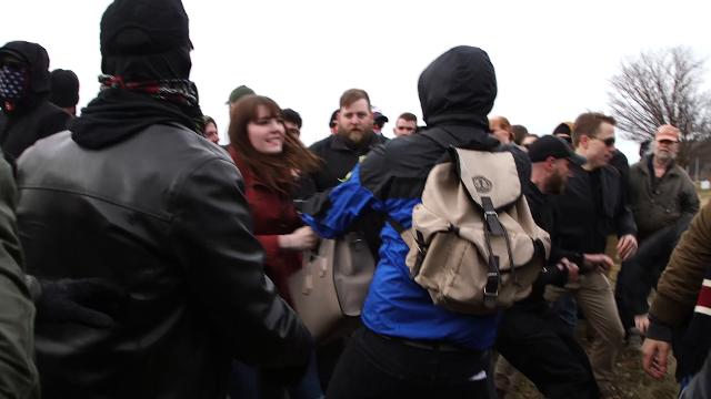 Protestors chant slogans and physically confront attendees who were going to see Richard Spencer speak on the campus of Michigan State University.