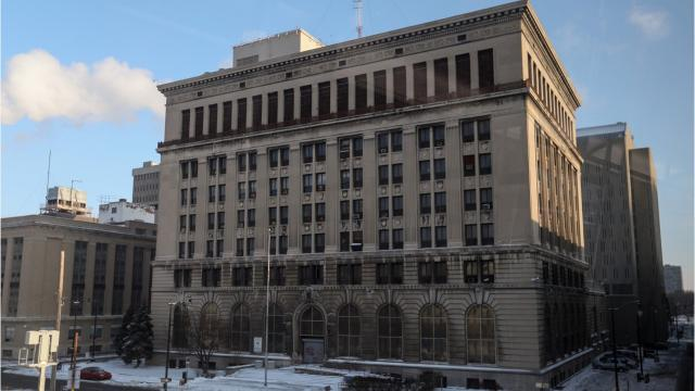 The old Detroit Police Department headquarters opened in 1922 at 1300 Beaubien. The building is filled with stories. The police department left it in 2013, and in 2018, businessman Dan Gilbert announced plans to redevelop it.